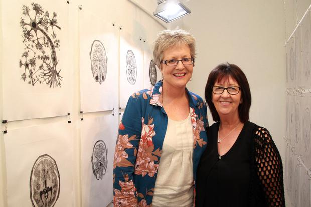 'The Dark and the Light' by Rita Ann Burke, pictured with her wife, Mitzie Murphy