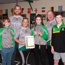 Mia Robbins, who won her fourth national championship title with from left, coach Michael Molloy, boxer Cillian Sheridan, coach George Clarke, coach and Mia's mother, Karen Robbins, coach Mark Sheridan and boxer, Jim Moorehouse.