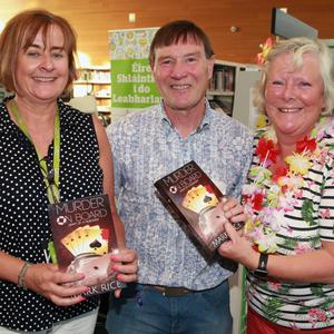 Author Mark Rice with librarian Barbara Nolan (left) and his wife Maria Rice