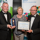 Bridget is pictured receiving her award from Dermot McGilloway, SVP National Retail Development Manager (left) and Noel Cassidy, SVP South East & Region Shop Manager at the Awards event held in the University of Limerick