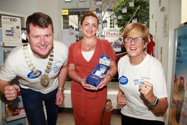 Cllr Malcolm Byrne, Boots store manager Karen Myler and staff member Imelda O'Connor at the launch of the Boots Night Walk in aid of the Irish Cancer Society