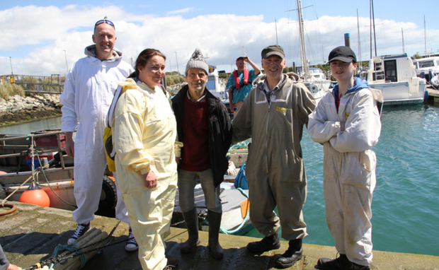 Members of the Menapian Bee Breeders Group on the quayside at Kilmore Quay about to set out to Saltee Little to set up an isolated mating station for Apis M.M. (from left) Stephen Kennelly, Grit Redmond, Patrick Grattan-Bellew (in background), John Goggin, John Morgan and Enda Morgan