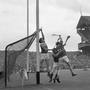 Wexford goalie, Pat Nolan, just manages to stop the ball from going over the bar as Tipperary forward, Sean McLoughlin (14), tries in vain to get the ball across during the 1968 All Ireland hurling final at Croke Park