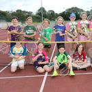 A group of children taking part in tennis lessons at the Fun in the Sun sports camp