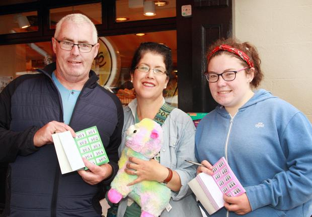 Transition year student Yasmin Fadian with her parents Gerry and Alison Fadian at her street raffle in aid of Bucharest trip to work at a Romanian orphanage