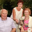 June Hill (centre) pictured with John and Marian Furlong