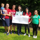 Jane and Barry Dempsey and family present their cheque to Fionnuala Sheehan of First Light