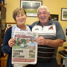 Tadhg's parents Margaret and James at their Campile home with last week's copy of their local paper