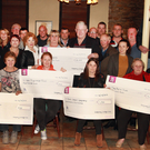 Front: Patsy Murray, Coolgreany handball, €250; Maureen Kelly, Coolgreany Tidy Towns, €500; Sarah Merrigan, Irish Pilgrimage Trust, €500; Yvonne Kinsella, ScoilIos again, €1,500 and Vera Grogan, May Byrne trust, €500. Back row: Geraldine O'Rafferty, Coolgreany Vintage Club sec; (centre back) with chairman Dan Kennedy with a cheque for St. Aidan's Services, €2,000. (Coolgreany Christmas lights also received €250)
