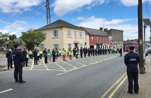 Members of the gardaí were joined by members of the emergency services, frontline workers and the public as they observed a minute's silence in memory of Detective Garda Colm Horkan outside Gorey Garda Station on Sunday