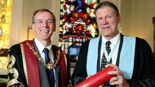 Kenneth Mealy, President of the Royal College of Surgeons presenting Wexford Festival Opera's departing Artistic Director David Agler with an Honorary Fellowship