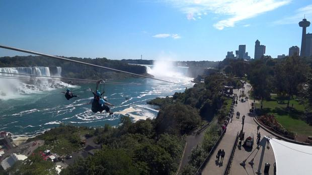 Our reporter Cathy Lee during a zip-line over the Niagara Falls in Ontario, Canada