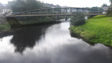 An imagining of what the new pedestrian bridge from the bottom of Slaney Street across to Templeshannon will look like