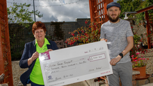 Chris Proby presents a cheque for €6,704 to Mary O'Brien of Arklow Cancer Support