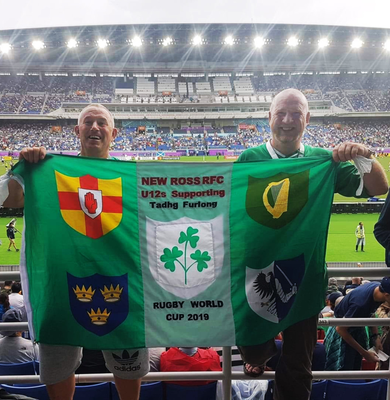 Padraig Bailey and a friend at the International Stadium with the U12s New Ross RFC banner