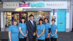 Pharmacist Michael Wade with his staff.