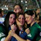 Relatives of Chapecoense soccer players cry during a memorial inside the team's stadium