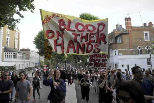 Protestors take to London's streets after the Grenfell Towers tragedy.