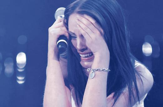 Ireland's Melanie McCabe breaks down onstage in the X Factor bootcamp.