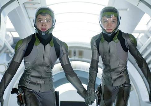 Hailee Steinfeld as Petra Arkanian and Asa Butterfield as Ender Wiggin in Ender's Game.
