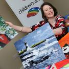 Marketing Manager Bronagh Carron viewing the Wexford entries for the Texaco art competition