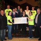 Organisers of the Gorey Night Run handing over a cheque to the North Wexford Hospice committee