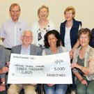 Front: John Maguire and Silvertones chairman Pearse Colbert presenting the cheque to Maria Condon and Una Murphy of Hospice Homecare. Back: Sheelagh O'Leary, Danny and Joan Lunn, Catherine O'Neill and Catherine Hurley