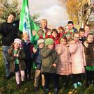 Ivan Kelly of Seal Rescue Ireland, who raised the green flag at St Kevin's NS Tara Hill, along with deputy principal Niamh Ward Carty and the green school committee