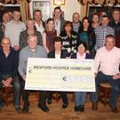 Organisers and winners of Taghmon's Got Talent present a cheque to Eithne Fitzpatrick of Wexford Hospice Homecare