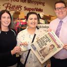 Amy Fenlon, Bellefield receives her €20 from Donna Murphy of People Newspapers and John Currid, assistant manager, Pettitt's SuperValu, Enniscorthy