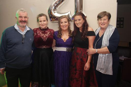 Katie Lee (centre) of Ahare, Castletown, is pictured in the Golden Anchor with her parents Aidan and Cathy and her sisters Megan and Niamh.