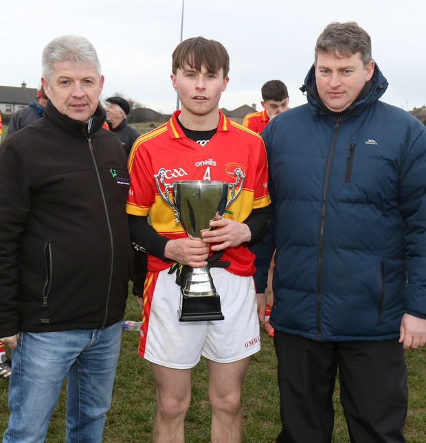 Andrew Egan from sponsors Greenstar with Horeswood captain David Murphy and David Tobin
