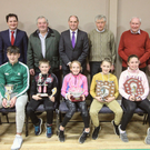 At the Bree AC awards ceremony were, back row: Nicky Cowman, Cllr. Cathal Byrne, Jim Corcoran, Paul Kehoe TD, Pat O'Leary, Micheal O'Leary and Frank Dunne. Front row: Abbie Doyle, Darrá Casey, PJ Breen, Ciara Laffan, Jayden Kenny, Leá Bolger and Katie Doyle