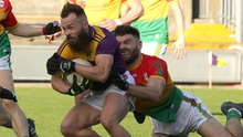 A determined Conor Carty is surrounded by a small army of Carlow opponents