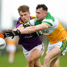 Wexford wing-back Ronan Devereux battling for the ball with Offaly's Jordan Hayes during Saturday's clash at Faithful Fields in Kilcormac