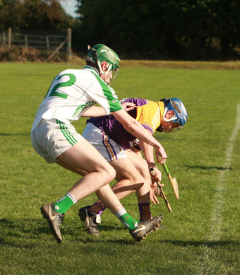 Brian Cadigan of St. Patrick's under pressure from Barry Levingston