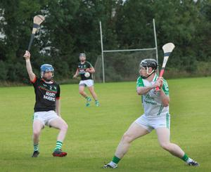 William Cullen strikes for Naomh Eanna as Kilmore's Shane Goff makes a blocking attempt