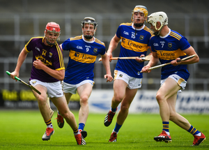 Wexford attacker Conall Clancy is faced down by Tipperary trio Jerome Cahill, Conor Bowe and Bryan O'Mara