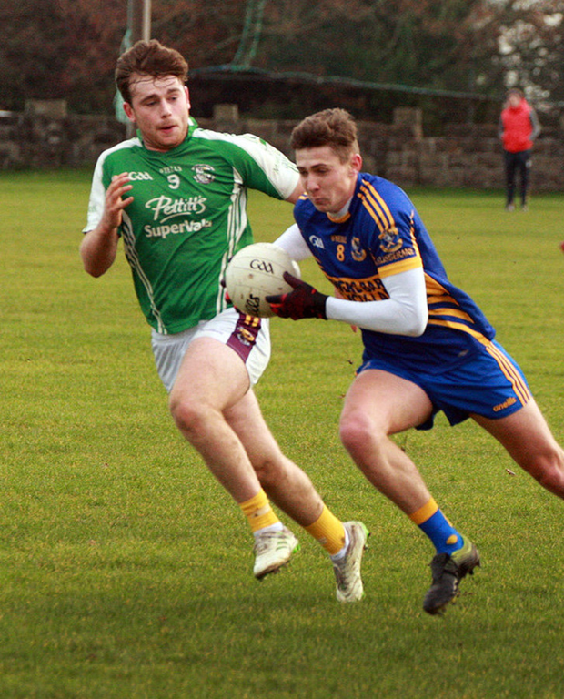 Gusserane's Gavin Sheehan on the move as Eoin Molloy gives chase