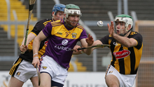 Wexford midfielder Aidan Rochford under pressure from Kilkenny pair John Donnelly and Paddy Deegan