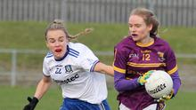 Wexford captain Niamh Butler is challenged by Maeve Monaghan