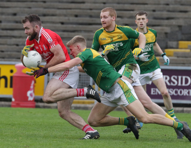 St. Mary's captain Christy Lane breaking away from HWH-Bunclody's Martin O'Connor and Páraic Sinnott