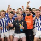 Good Counsel players celebrate with joint team manager Declan Wall, a past pupil of the school who was completing a glorious six days as he had guided his native Mullinavat to the AIB Leinster Intermediate hurling title on the previous Sunday when they beat Kiltale of Meath by 1-13 to 0-13 in Navan