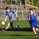 Darragh Joyce, Good Counsel and Corey Reid, Marist. College game in Dr. Cullen Park, Carlow. Photo Joe Byrne