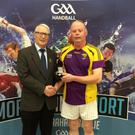 Mick Armstrong is congratulated by national handball President Willie Roche who is a Wexford native