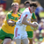 Rory Brennan of Tyrone is tackled by Anthony Thompson of Donegal during the Ulster final
