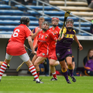 Shelley Kehoe of Wexford attempts to gather possession as Cork centre-back Gemma O'Connor prepares to pounce