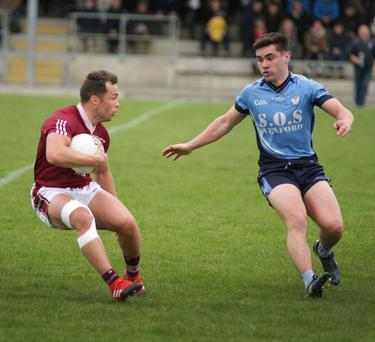 Conor Carty of Castletown is confronted by Jack Murphy (St. Anne's)