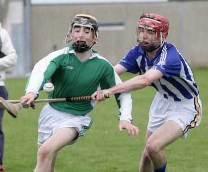 Conor Roche of St. Peter's tussles with Luke Byrne-Doyle