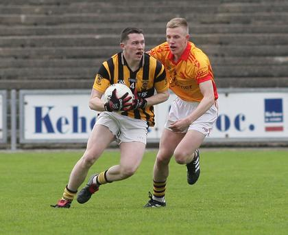 Graham Staples under pressure from John Bridges (Sarsfields)